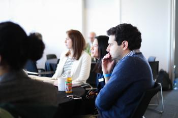 Several Pearson Fellows and Harris Public Policy students staring in concentration during The Darker Side of Peace Agreements conference, held by The Pearson Institute in May 2019.